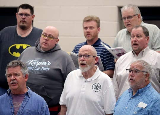 Singers from the MacDowell Male Chorus rehearse at Xavier High School on April 15 in Appleton.