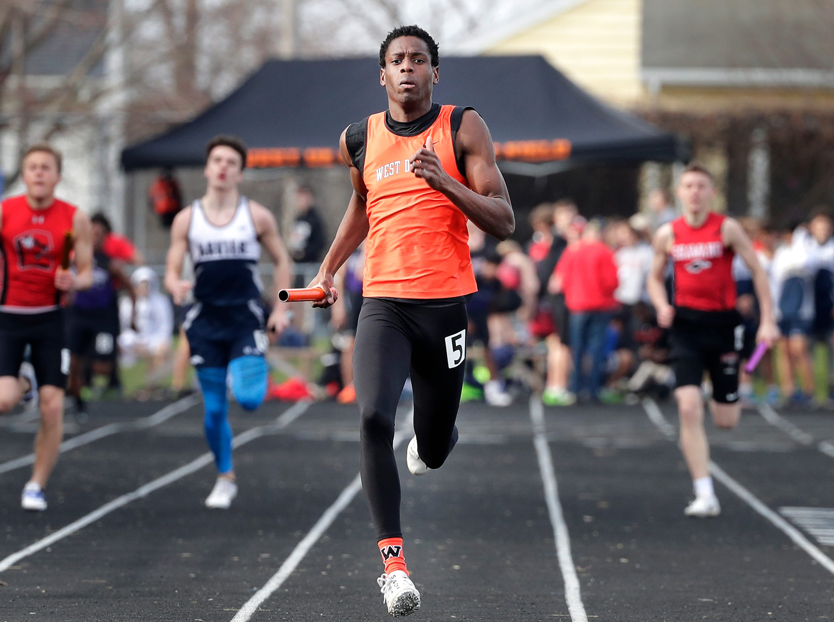 West De Pere High School's Tejay Evans competes in the 4 x 200m relay during a Bay Conference Relays track and field meet  on Tuesday, April 16, 2019 at Xavier High School, in Appleton, Wis. Wm. Glasheen/USA TODAY NETWORK-Wisconsin.