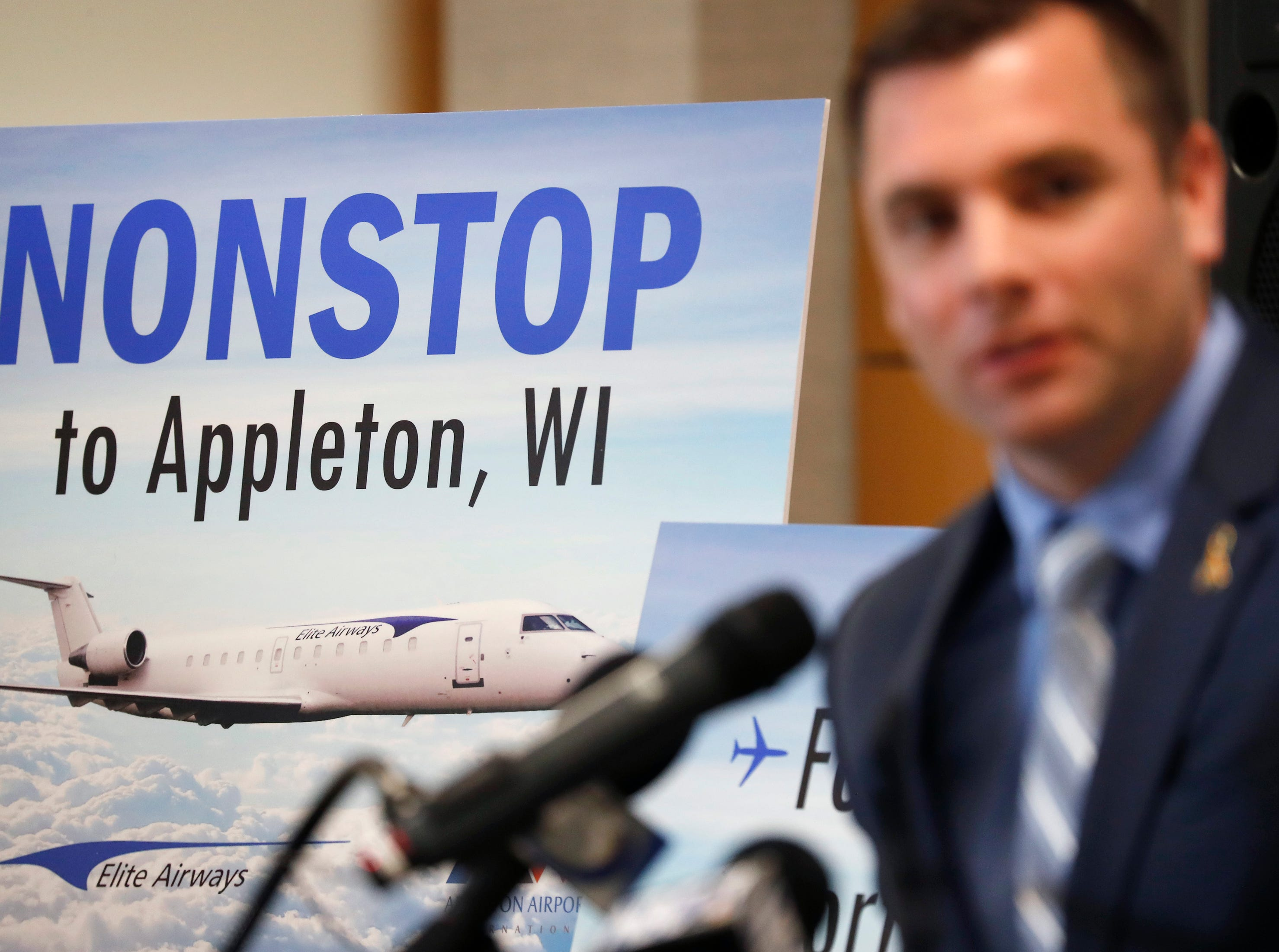 Appleton International Airport director Abe Weber speaks at the announcement of nonstop charter flights from Elite Airways departing from Fort Worth, Texas, Melbourne, Fla., and Portland, Maine during EAA AirVenture Wednesday, April 17, 2019, in Greenville, Wis. This will be EAA AirVenture's 50th anniversary.Danny Damiani/USA TODAY NETWORK-Wisconsin