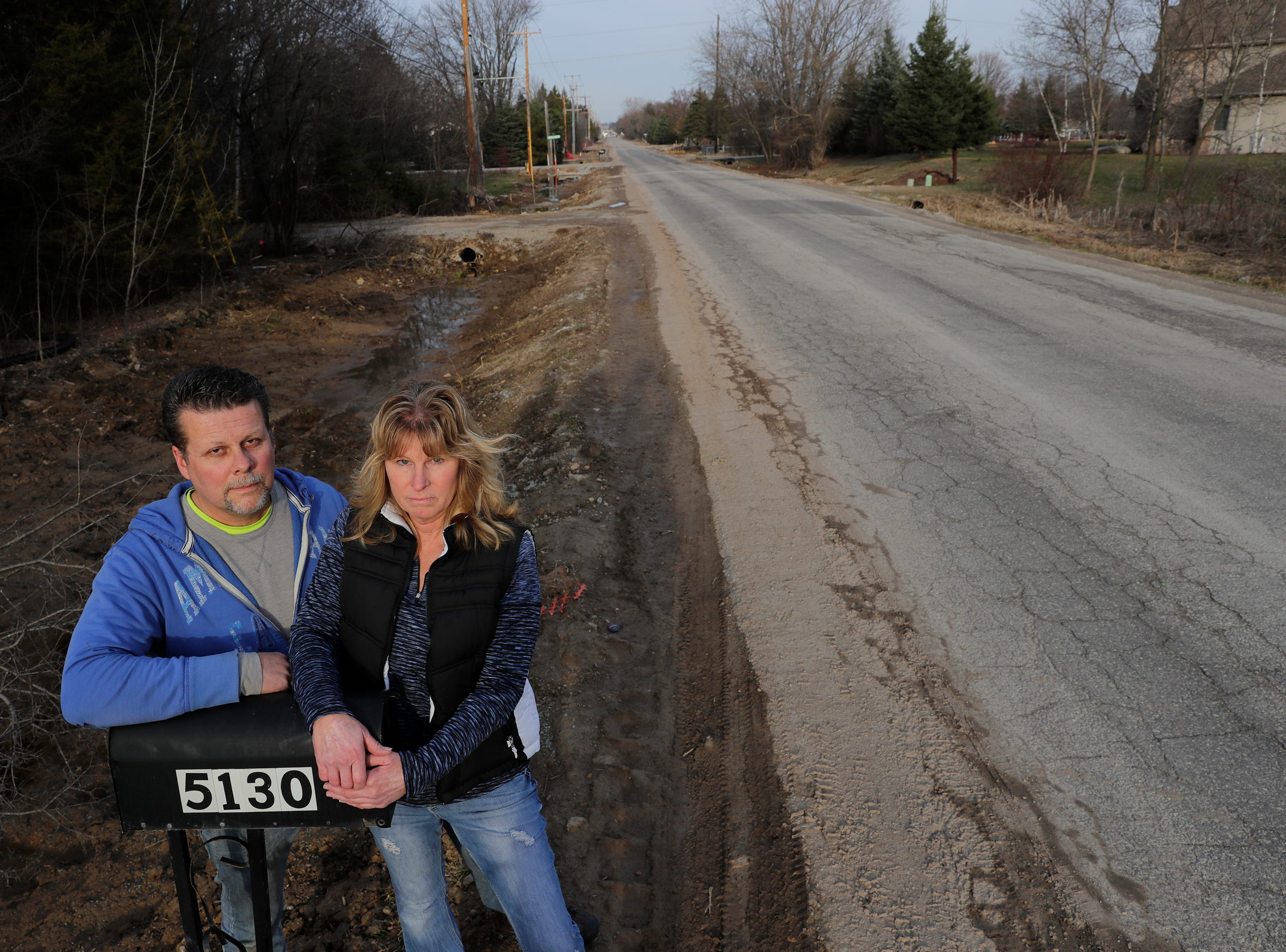 Residents David Mischler, left, and Patti Stenson are facing a $16,386 special assessment for the urbanization of Spencer Street between Casaloma Drive and Mayflower Drive. They are pictured here in front of the home located at 5130 W. Spencer Street Tuesday, April 16, 2019, Grand Chute, Wis. Dan Powers/USA TODAY NETWORK-Wisconsin
