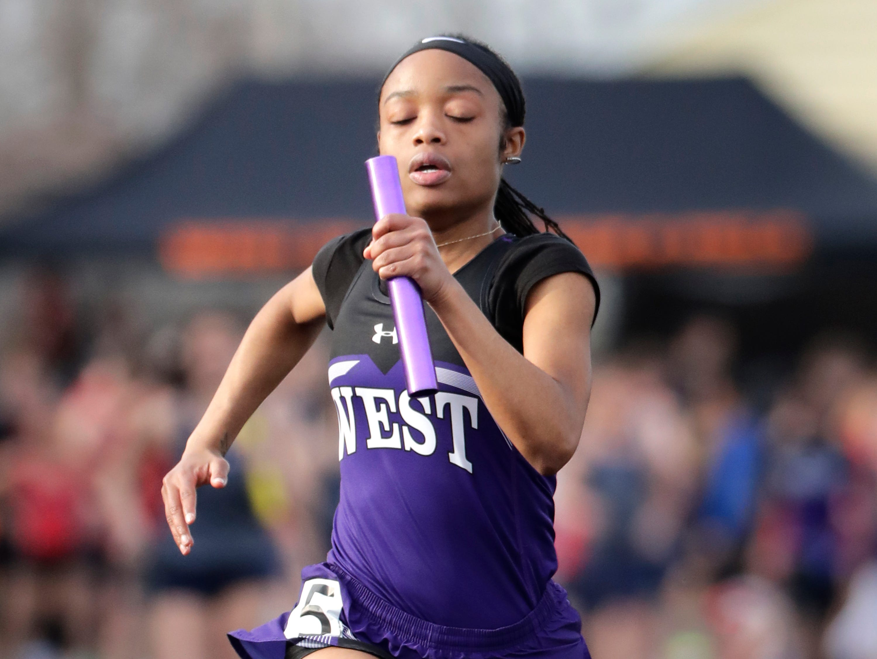 West De Pere High School's Zharia Wells competes in the 4 x 800m relay during a Bay Conference Relays track and field meet Tuesday, April 16, 2019 at Xavier High School, in Appleton, Wis. Wm. Glasheen/USA TODAY NETWORK-Wisconsin.