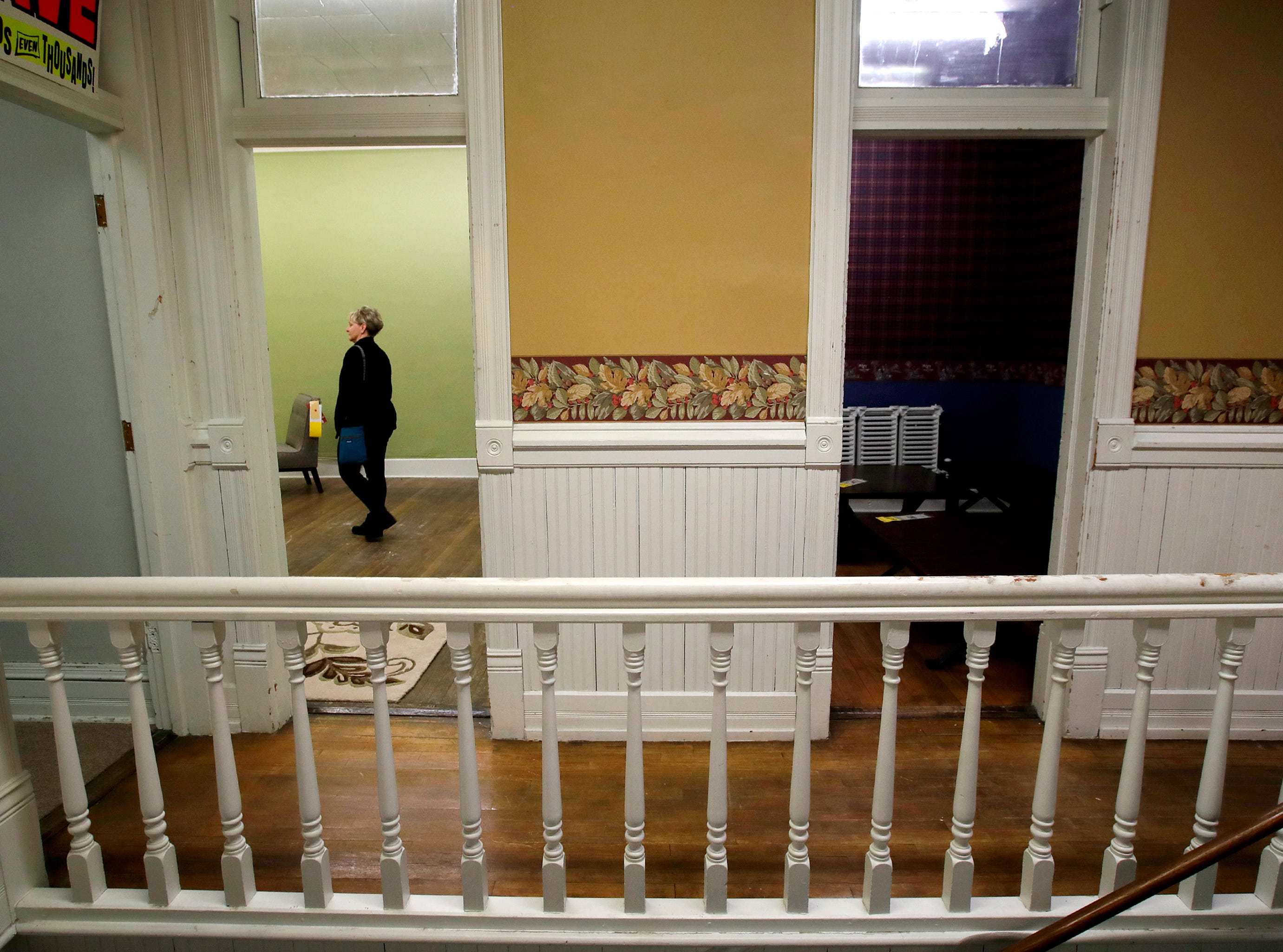 Laura Sinclair, of Appleton, walks through Gabriel Furniture Thursday, April 18, 2019, in Appleton, Wis. The building that houses the furniture store was built in 1888.Danny Damiani/USA TODAY NETWORK-Wisconsin