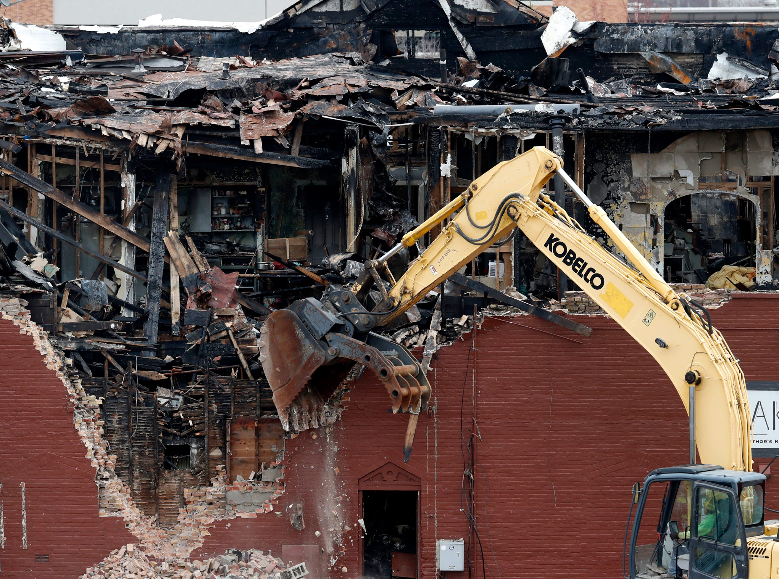 Demolition begins on the building that housed Author's Kitchen and Bar and apartments on the corner of West Washington and North Appleton Streets Monday, April 22, 2019, in Appleton, Wis. 