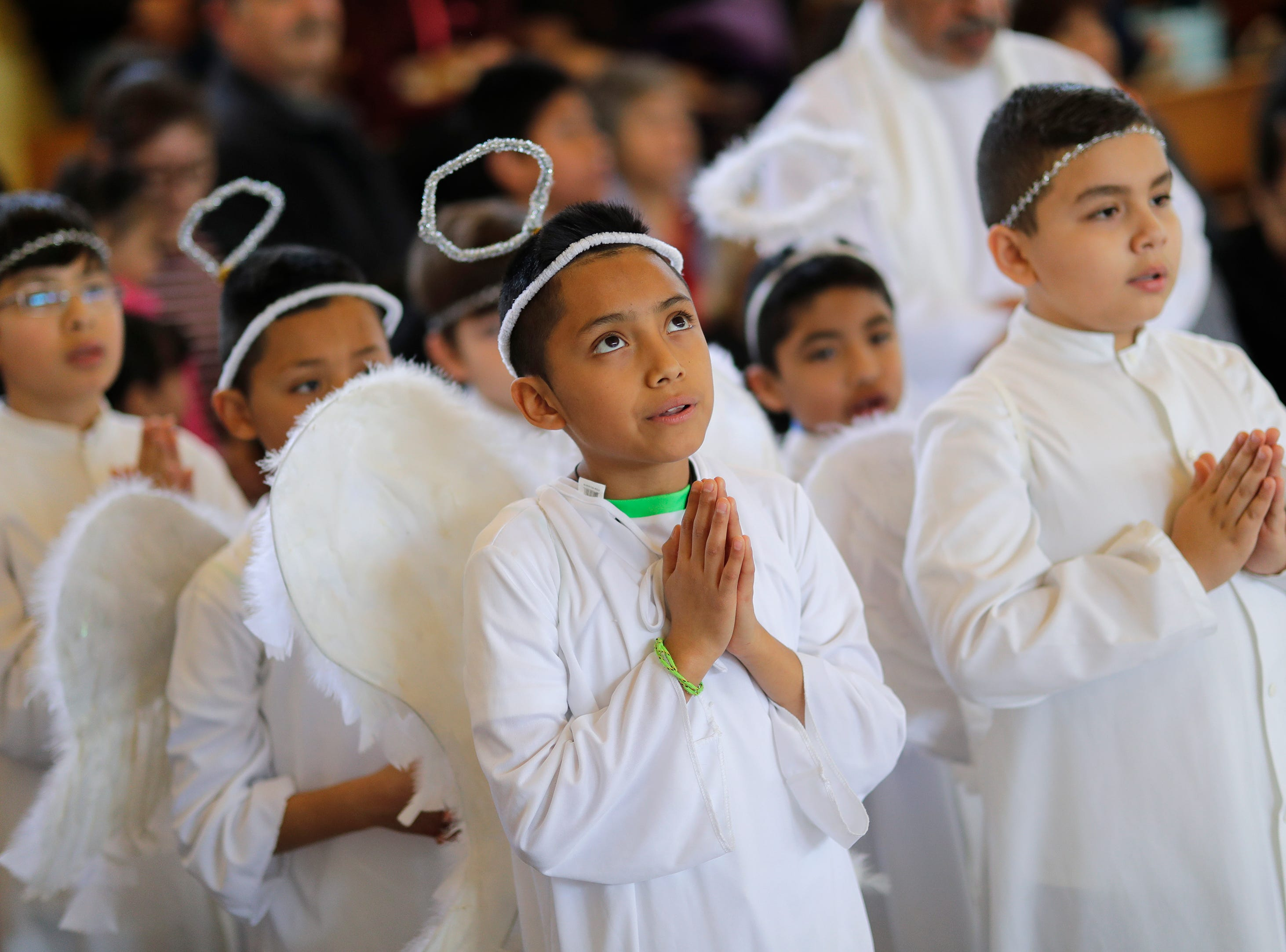 St. Therese Parish members Josue Vazqueze-Zacrias, 10, left, and Roberto Gonzalez, 10, participate in a Passion Play and the Stations of the Cross Friday, April 19, 2019, in Appleton, Wis. Dan Powers/USA TODAY NETWORK-Wisconsin