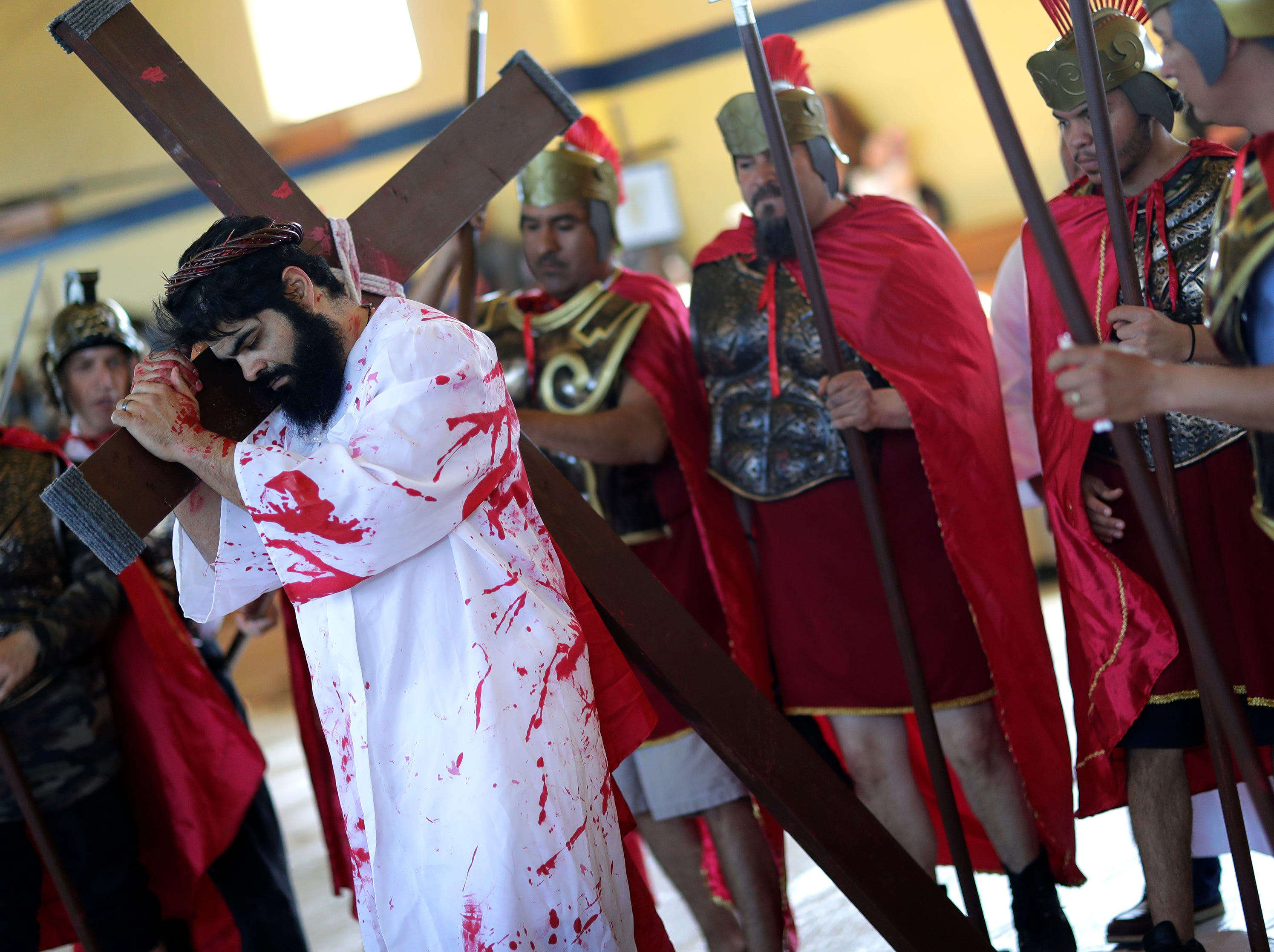 St. Therese Parish member Marcos Cisneros plays the part of Jesus during a Passion Play and completes the Stations of the Cross Friday, April 19, 2019, in Appleton, Wis. Dan Powers/USA TODAY NETWORK-Wisconsin