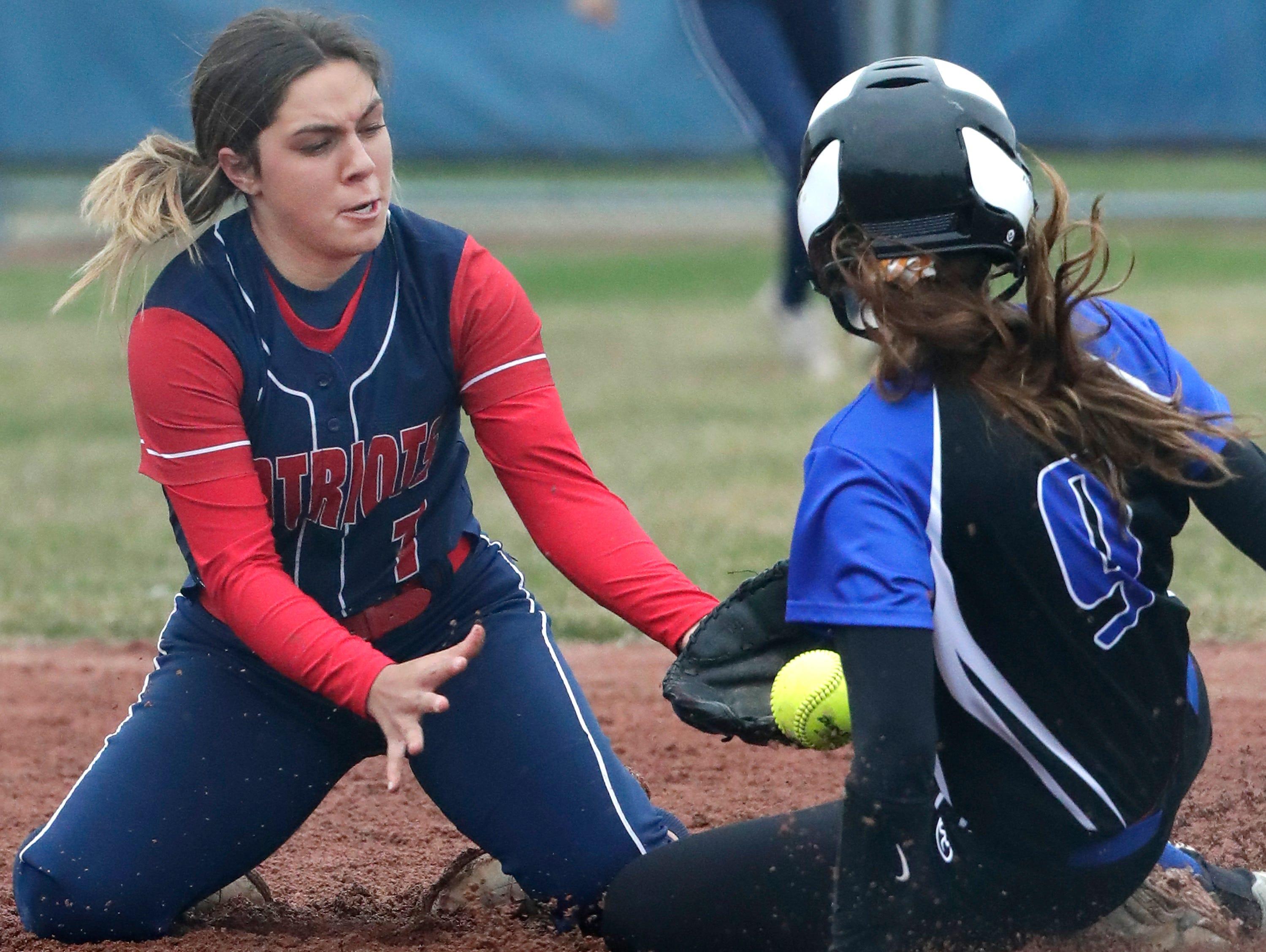Appleton East High School's #7 Marissa Englemann against Oshkosh West High School's #9 Brieann Kitchen during their softball game  on Thursday, April 18, 2019, in Appleton, Wis. Wm. Glasheen/USA TODAY NETWORK-Wisconsin.