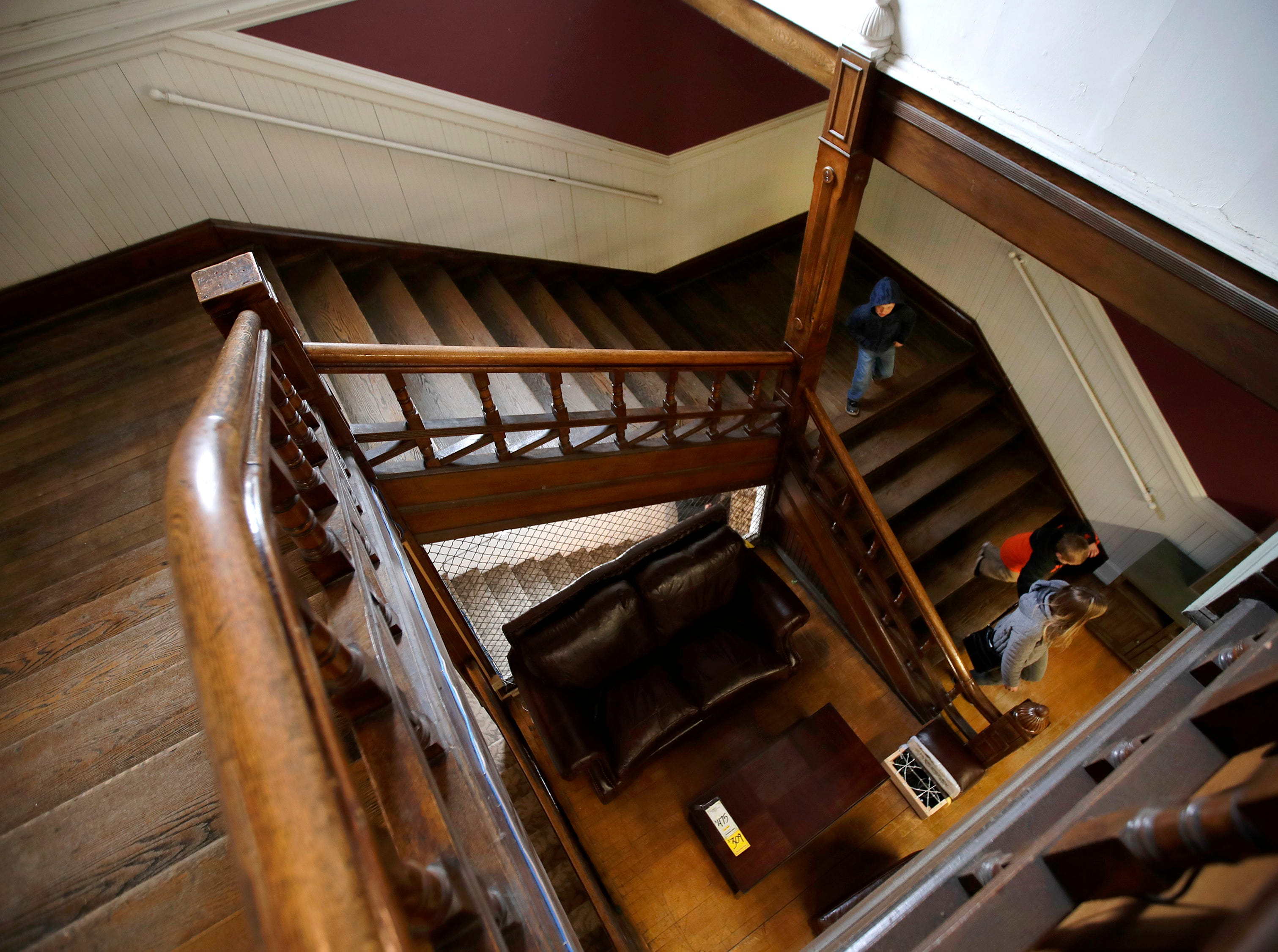 Kayla Hendricks, of Appleton, walks down the grand staircase in Gabriel Furniture with her sons Charlie, 5, and Bennett, 3, while looking around the building Thursday, April 18, 2019, in Appleton, Wis. Hendricks used to visit the building, which was built in 1888, as a child. The staircase is original to the building.Danny Damiani/USA TODAY NETWORK-Wisconsin