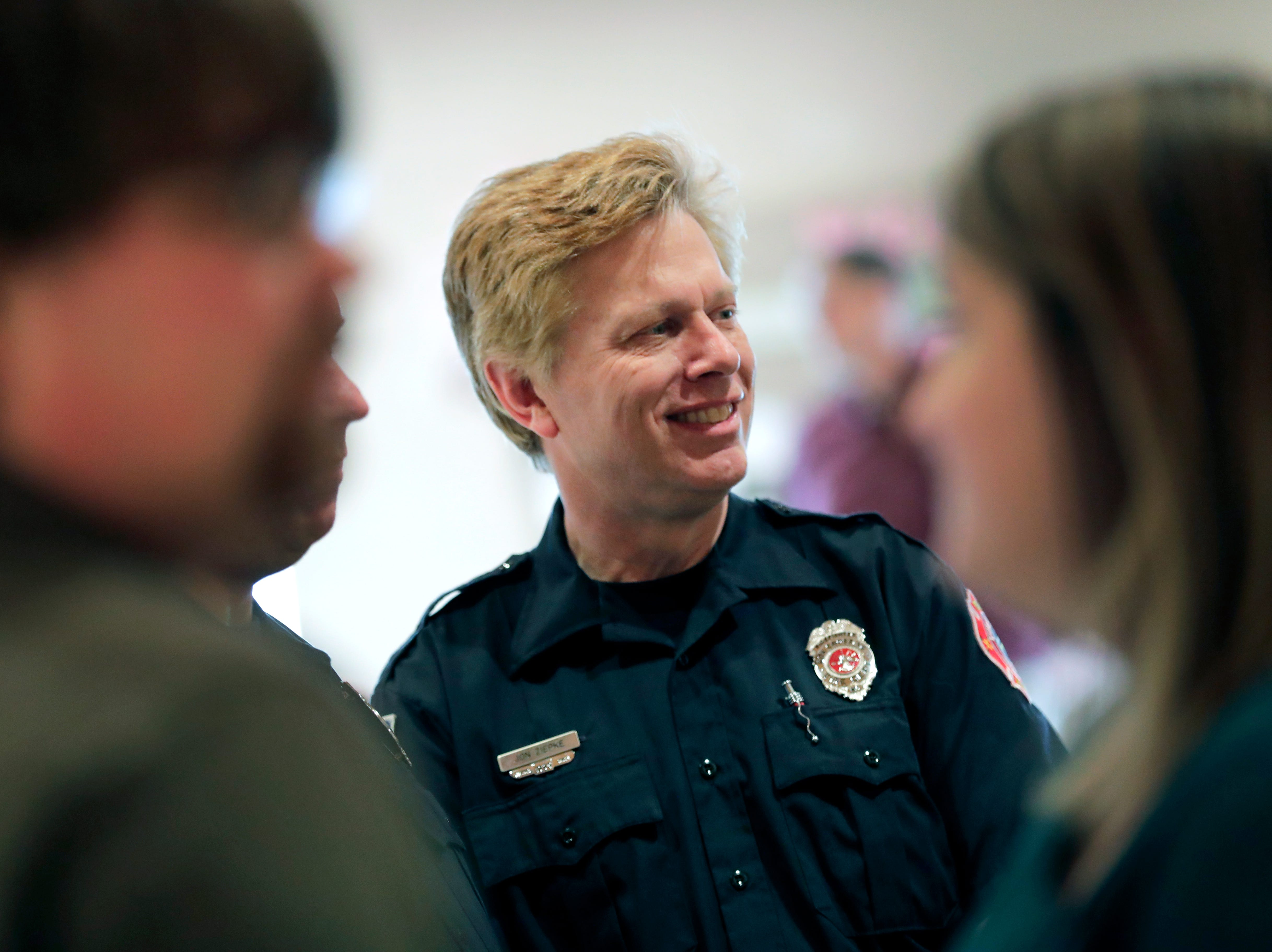 John Ziebke, a firefighter with the Fox Crossing Fire Department, talks with other responders during the I-41 Mass Casualty Incident of Feb. 24, 2019 Recognition Event Tuesday, April 16, 2019, at Gloria Dei Lutheran Church in Neenah, Wis. Dan Powers/USA TODAY NETWORK-Wisconsin