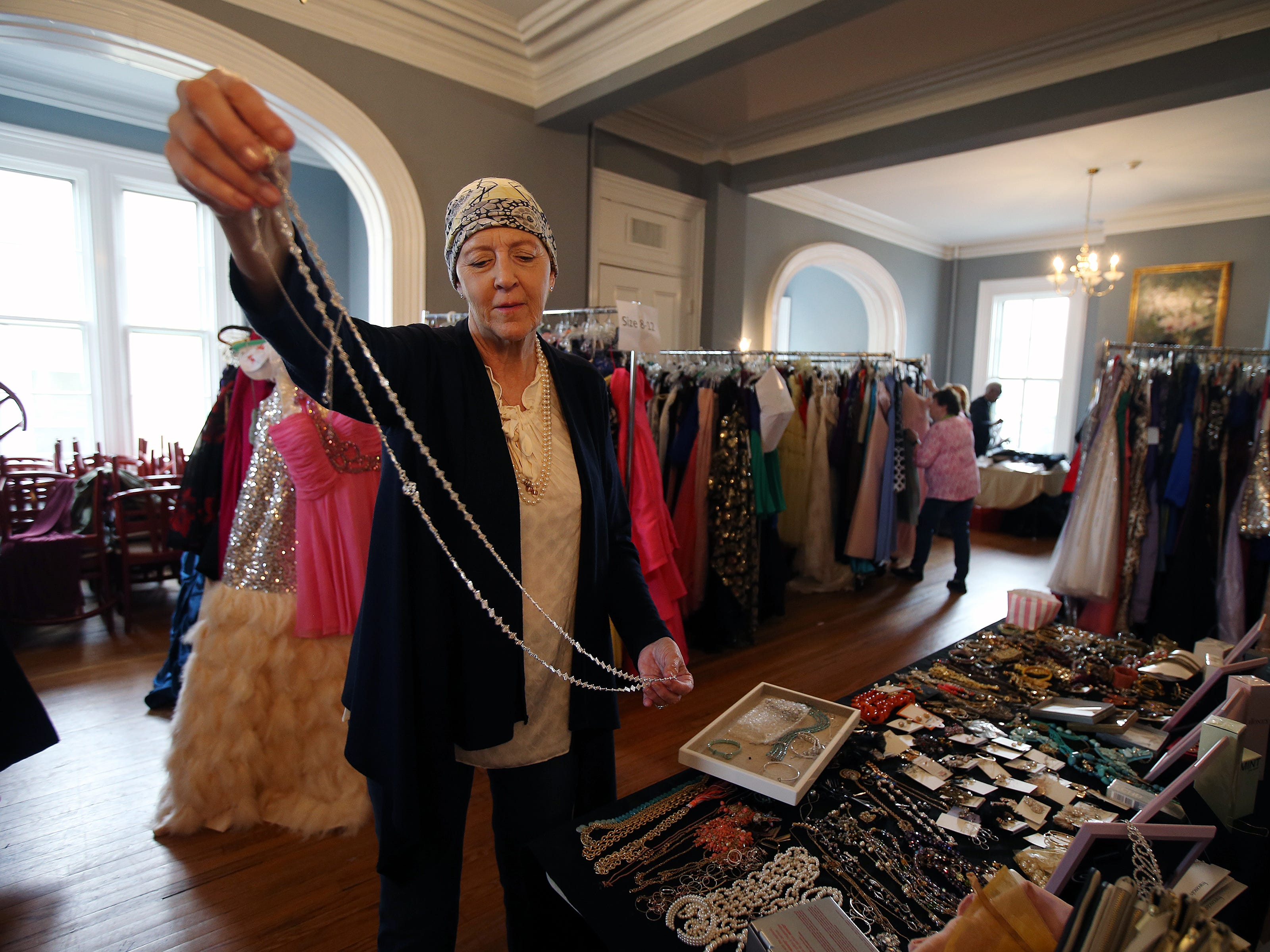Dorothy Bailey of Rumson, a volunteer who collected jewelry from local vendors and the community, creates a table display of jewelry during the Lunch Break's 4th Annual Prom Giveaway Event at the Woman's Club of Red Bank in Red Bank, NJ Monday, April 22, 2019.