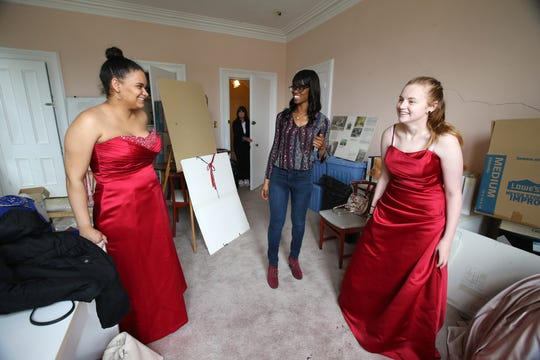 (center) Melia Owens of Neptune, program coordinator, helps (left) Abril Mendoza, 17, of Manahawkin and (right) Emily Maldonado, 18, of Manahawkin find the perfect prom dress during the Lunch Break's 4th Annual Prom Giveaway Event at the Woman's Club of Red Bank in Red Bank, NJ Monday, April 22, 2019.