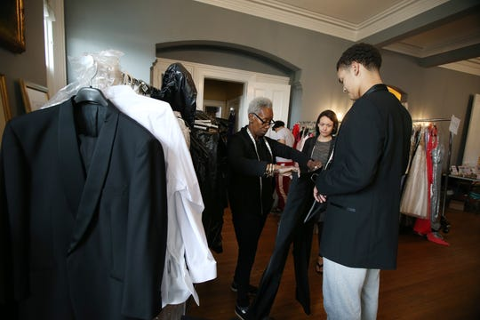 """Inice Hennessy of Tinton Falls, a volunteer known as """"Lunch Break's professional stylist, helps Malik Fields, 15, of Neptune find the perfect tuxedo during Lunch Break's 4th Annual Prom Giveaway Event at the Woman's Club of Red Bank in Red Bank, NJ Monday, April 22, 2019."""