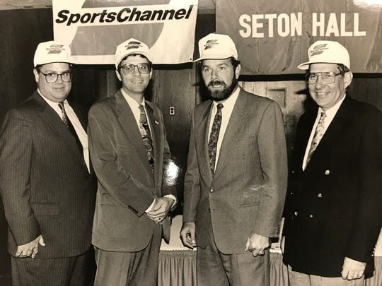 Seton Hall AD Larry Keating (far left) and basketball coach P.J. Carlesimo (right center) join Bob Mulcahy (far right) at a press conference about a SportsChannel announcement.