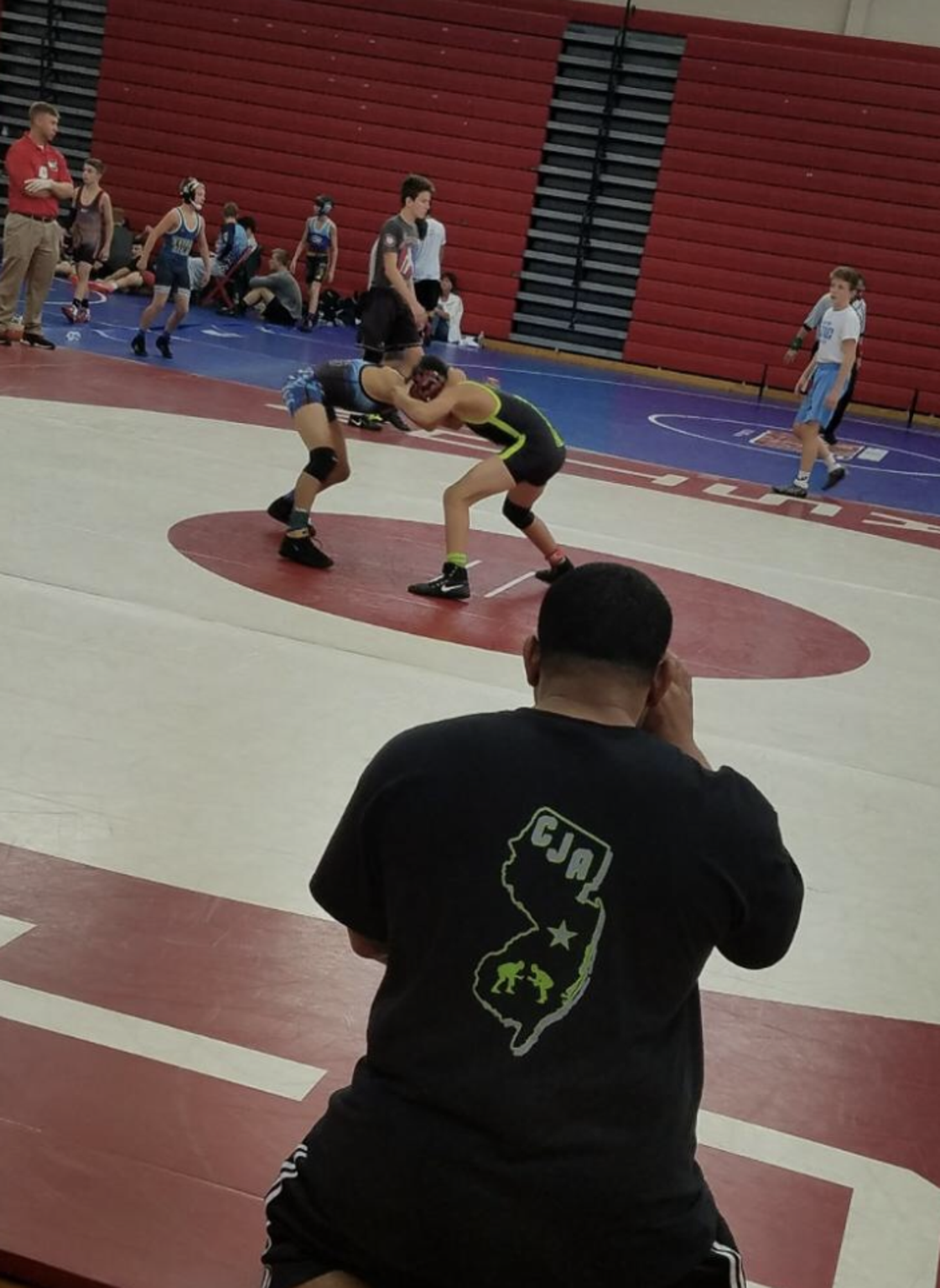 In an undated photo, Onezimo Diaz takes video of his son Nicholas during a wrestling match.
