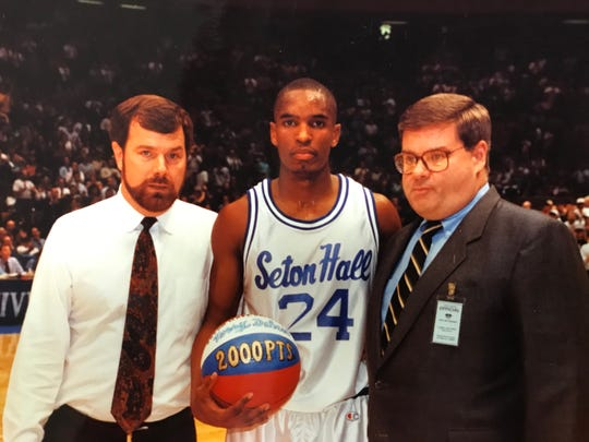 Larry Keating (right) and P.J. Carlesimo (left) present Seton Hall star Terry Dehere with a commemorative ball in 1993 for scoring 2,000 collegiate points.