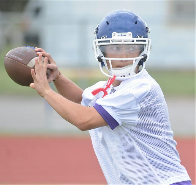 Cooper quarterback Noah Bjorlie throws a pass during a drill on the Cougars' first day of spring football on Monday, April 22, 2019, at the Cooper practice field. The Coogs' spring game will be May 16 at Shotwell Stadium.