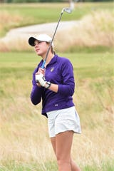 Wylie's Maddi Olson watches a shot during the first round of the Region I-5A tournament on Monday. Olson shot a first-round 75 and is in 14th place individually.