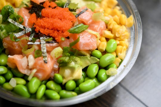 The Poke Doke bowl at Aloha Cafe is made with salmon, avocado, corn, edamame, sweet onions, rice seasoning, masago, scallions, shredded seaweed and ponzu sauce and is served on rice.
