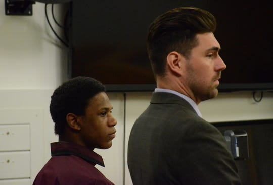 Davion Brown, left, stands with his attorney, Caleb Grimes just before a jury acquitted him of murder.