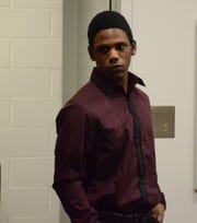 Davion Brown enters the courtroom Monday before he was acquitted of murder by a jury.