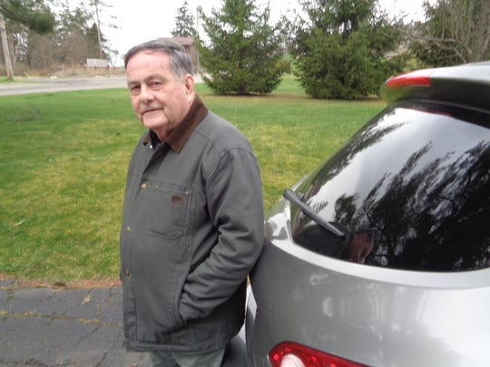 Gary Hamelin and his car. Hamelin is a volunteer driver for the American Cancer Society's Road to Recovery program.