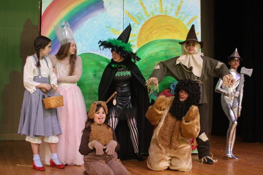 """From left: Isabella Williams (Dorothy), Katie Matthews (Glinda), Hannah Reilly (Toto), Shannon Hayes (Miss Gulch), Cash Vaughn (Lion), Liam Roma (Scarecrow) and Nick Goudarzi (Tin Man) will be performing Cast A of The Catholic Schools of Broome County's production of """"The Wizard of Oz"""" on Thursday and Saturday."""