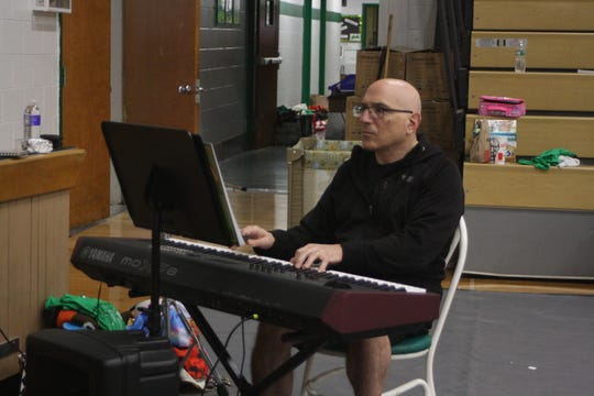 """Jan DeAngelo, the music director of Catholic Schools of Broome County's upcoming production of """"The Wizard of Oz,"""" accompanies the cast during a rehearsal on April 22."""