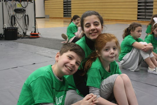 """From left: Siblings Mark, Mary and Ann Redmore, pictured at an April 22 rehearsal, will all perform in the cast of Catholic Schools of Broome County's upcoming production of """"The Wizard of OZ."""""""