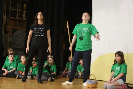 "Lynette Shear (left) interprets Shannon Hayes' performance as The Wicked Witch of the West (right) in the Catholic Schools of Broome County's production of ""The Wizard of Oz."""