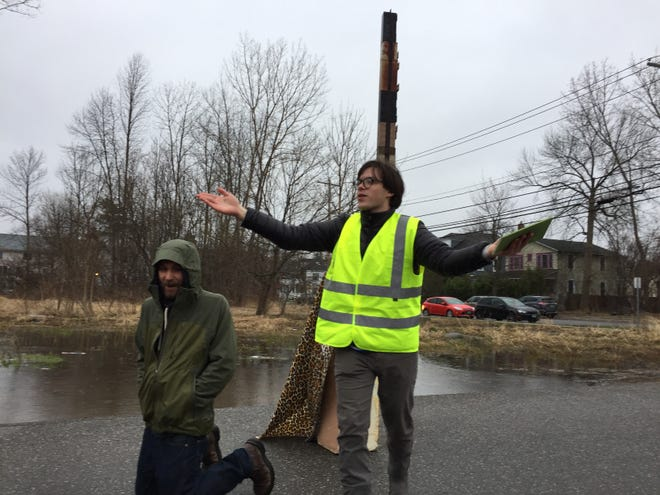 Griffin Jones led the ceremony as about two dozen people gathered to worship the world's tallest filing cabinet in Burlington on April 19, 2019.