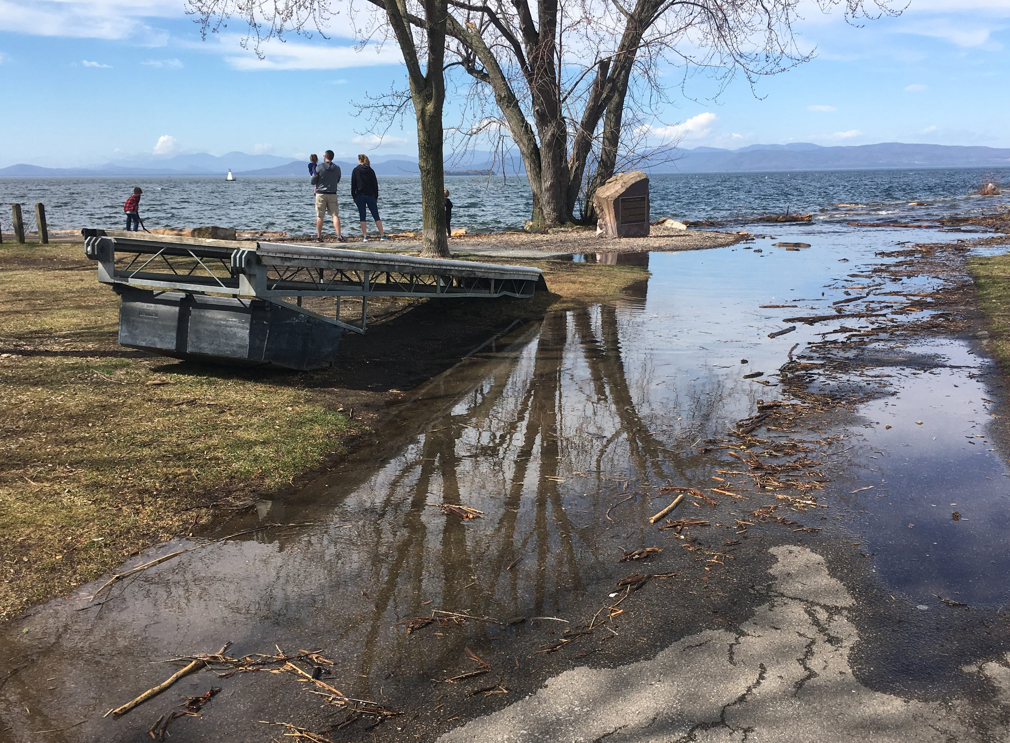 A family gathers on high ground to admire Lake Champlain at Perkins Pier in Burlington on Sunday, April 21, 2019.