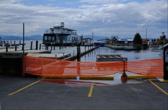 The waters of Lake Champlain flood the King Street ferry terminal in Burlington on Sunday, April 21, 2019.