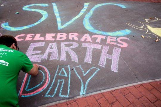 Brandon Mandigo, a student at Texas A&M University-Corpus Christi, creates a chalk mural for Earth Day as the university kicks off a weeklong Earth Week on Monday, April 22, 2019.