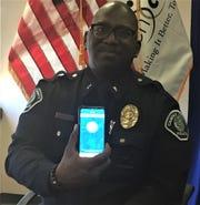 Camden County Police Lt. Zshakhiem James displays the STOPit app.