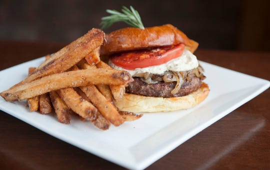 This Be Square Burger from Center Square Tavern features tomato, caramelized onions and house-cut fries,  with plenty of chances for add-ons.