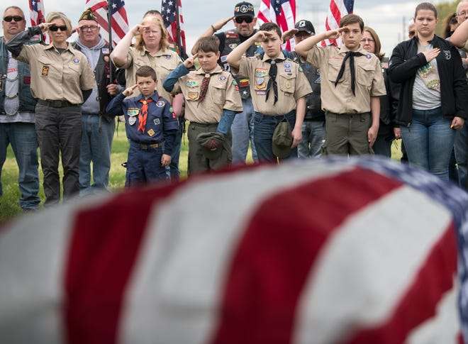 A group of Boy Scouts from different towns salute US Army Veteran Robert Grala, a veteran with no known next of kin, as Grala is laid to rest with full military honors during a ceremony at the Gloucester County Veterans Cemetery in Williamstown on Monday, April 22, 2019.