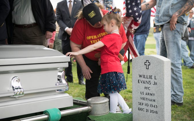 Marley Davis, 4 of Glassboro, stands with her great-aunt Joni Harrison of Franklinville, and places her hand on the casket of US Army Veteran Robert Grala, a veteran with no known next of kin, during the burial service for Grala held at the Gloucester County Veterans Cemetery in Williamstown on Monday, April 22, 2019.