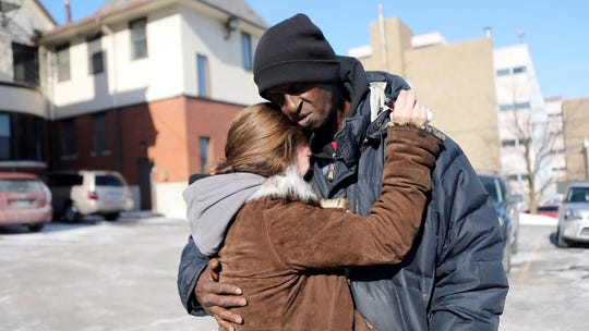 Lindsey Bolar comforts a young woman addicted to heroin. He took her in January 2018 to an addiction center and a hospital as she sought  treatment, but neither had space for her. (Enquirer File)