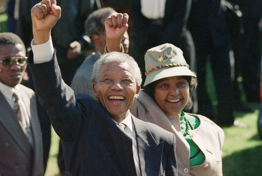 Nelson Mandela and his wife, Winnie Mandela, greet a crowd in 1991.