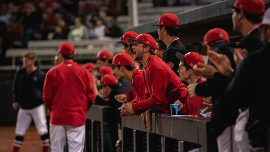 Austin Peay players cheer on the Govs against Morehead State on April 12.
