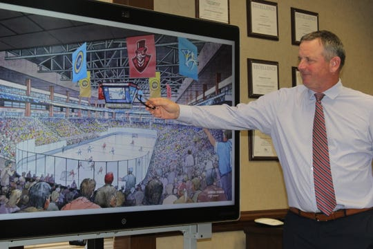 Montgomery County Mayor Jim Durrett shows off an artist rendering of the interior of the proposed downtown multi-purpose event center.