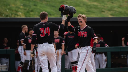 Austin Peay's Matt Joslin (34) and Garrett Spain celebrate after scoring a run against Morehead State on April 12.