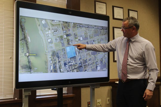 Montgomery County Mayor Jim Durrett shows the proposed site of the downtown multi-purpose event center, at Second and College Streets.
