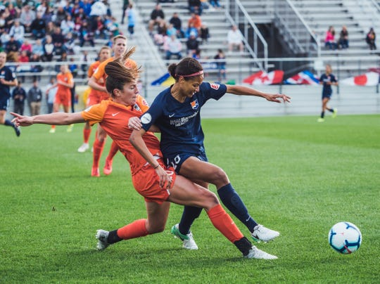 Sky Blue FC forward Imani Dorsey tangles with Houston's Lindsay Agnew in first half action.