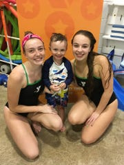 Y swim instructors with a student.