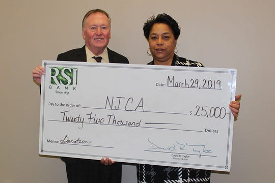 Donald Godfrey, EVP & Chief Lending Officer of RSI Bank, presents a check to Bonita Holmes on behalf of New Jersey Citizen Action.