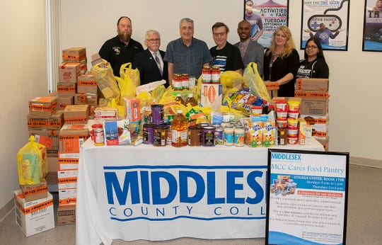 The Edison Elks #2487 recently donated $2,500 worth of food to the Middlesex County College (MCC) Food Pantry. (Left to right) Doug Pearson, past exalted ruler of the chapter; College President Mark McCormick; Ron Hayes, Elks grants coordinator; George Yusko, Elks veterans chair; Odé Hoppie, MCC's director of student life; Mary Tutalo, coordinator of student life and the food pantry; and Jenifer Olvera, who works in the food pantry.