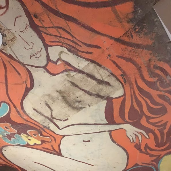 Mysterious painting of a naked woman discovered in south-side Des Moines home