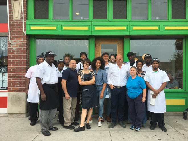 """The staff of Russell Street Deli pose with TV host Andrew Zimmern during filming of the Travel Channel's """"The Zimmern List"""" in September 2018. The deli closed September 28, 2019."""