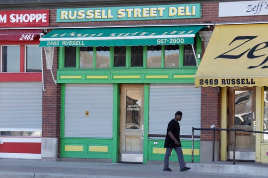 A man walks past Russell Street Deli in Eastern Market on Monday, April 22, 2019.