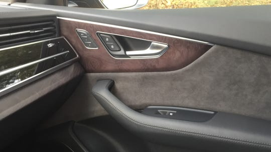 The Q8's interior features wood, aluminum and other appealing materials